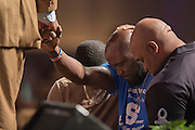 Adrian Taylor (blue) prays with pastor Wm. Dwight McKissic, Sr. and his sons during a memorial service for his son Christian Taylor at Cornerstone Baptist Church in Arlington, Texas on August 12, 2015. (Cooper Neill for The New York Times)
