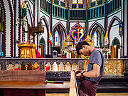 26 NOVEMBER 2017 - YANGON, MYANMAR: Workers in St. Mary's Cathedral set up dividers for Pope Francis' mass in the cathedral. The Pope will visit Yangon November 27 - 30. He will have private meetings  with government officials, military leaders and Buddhist clergy. He will also participate in two masses, a public mass in a sports complex on November 29 and a mass for Myanmar youth in St. Mary's Cathedral on November 30.    PHOTO BY JACK KURTZ