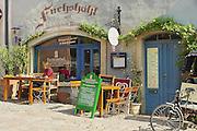MEISSEN, GERMANY - MAY 22, 2010: Unidentified lady has breakfast in a cafe at the downtown Meissen in Meissen, Germany.