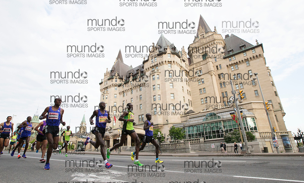 (Ottawa, Canada---24 May 2015) The men's race lead pack running past the Chateau Laurier at the start of the marathon during the Tamarack Run Ottawa Race Weekend.
