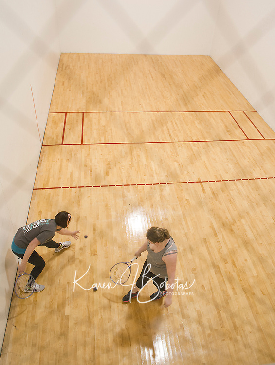 Hillary Stanley and Mikenzie Watson enjoy a game of racquetball on the court at the Laconia Community Center on Wednesday afternoon.  (Karen Bobotas/for the Laconia Daily Sun)