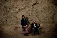 An old couple take a brak during the procession of Santa Cecilia in Caspana, Atacama desert, Chile. November 2009.