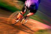 CYCLING - Action of a fast downhill leisure mountain biker SPORT
