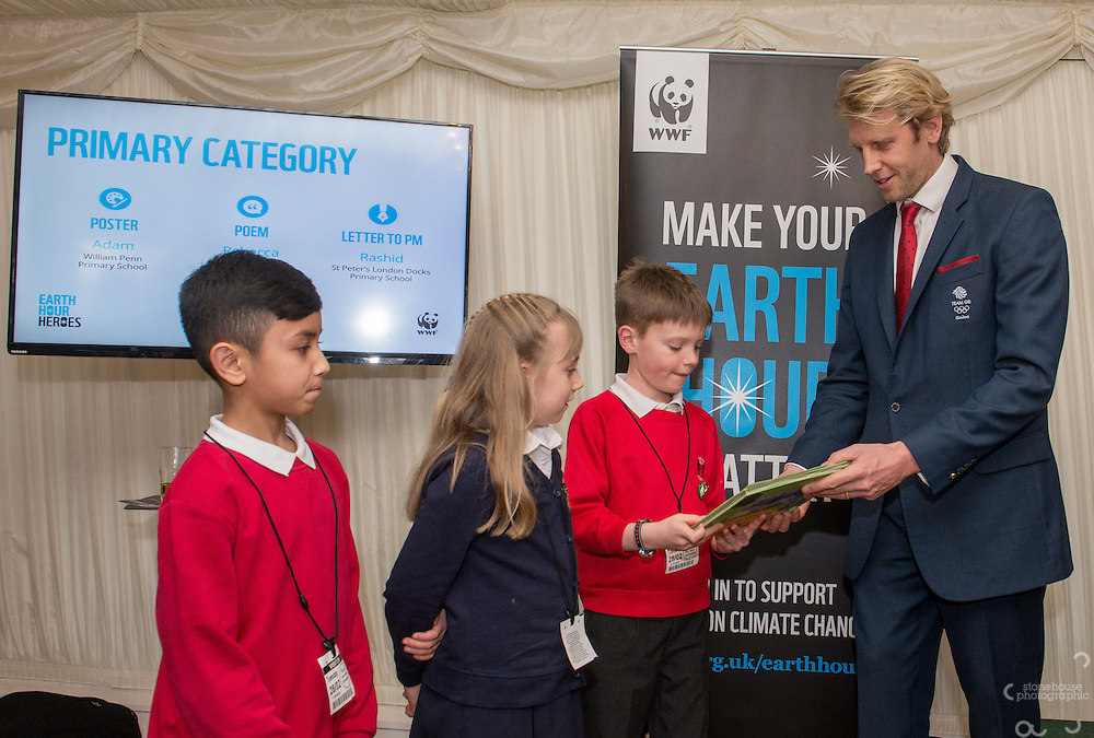 Andrew Triggs Hodge OBE presenting School Awards primary category winners Rashid (Letter to PM), Rebecca (Poem) and Adam (Poster) during the WWF UK Earth Hour 10th Anniversary Parliamentary Reception, Terrace Pavilion, Palace of Westminster. 28th Feb. 2017
