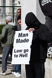 "© Licensed to London News Pictures . 20/06/2010 . London , UK . "" Man made law go to hell "" placard . A Muslims Against Crusades demonstraion calling for Sharia Law for All , on Richmond Terrace , Whitehall , opposite Downing Street . Photo credit: Joel Goodman/LNP"