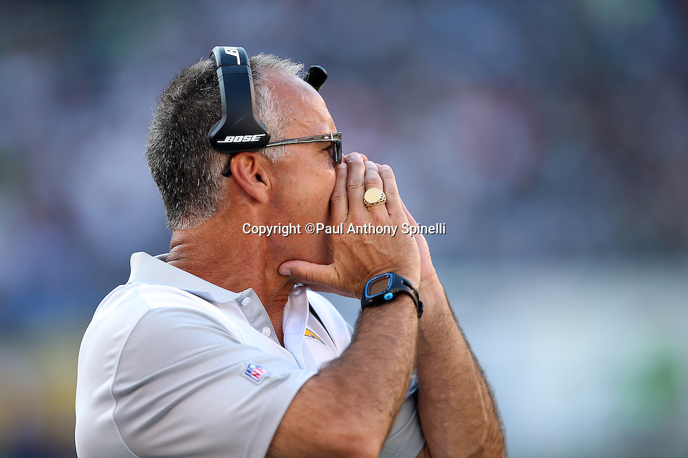 San Diego Chargers linebackers coach Mike Nolan yells out from the sideline during the 2015 NFL preseason football game against the Seattle Seahawks on Saturday, Aug. 29, 2015 in San Diego. The Seahawks won the game 16-15. (©Paul Anthony Spinelli)