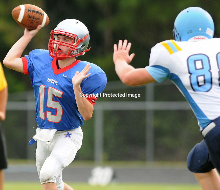 Pender High School's Jake Rawls passes against East Crteret in the opening game of The Pender County Jamboree Saturday August 16, 2014 at Trask High School. (Jason A. Frizzelle)