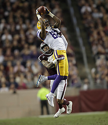LSU wide receiver D.J. Chark (82) catches a pass as Texas A&M defensive back Priest Willis (24) defends during the first quarter of an NCAA college football game Thursday, Nov. 24, 2016, in College Station, Texas. (Sam Craft/The Eagle)