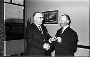 07/02/1964<br /> 02/07/1964<br /> 07 February 1964<br /> Esso staff presentations in Esso premises at Alexandra Road, Dublin. Mr Denis Dunne (left), Director at Esso Petroleum Company (Ireland) Ltd. presenting award.