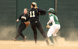30 March 2013:  Emma Clark runs the bases while the ball is handled by Gwen Anderson during an NCAA Division III women's softball game between the DePauw Tigers and the Illinois Wesleyan Titans in Bloomington IL