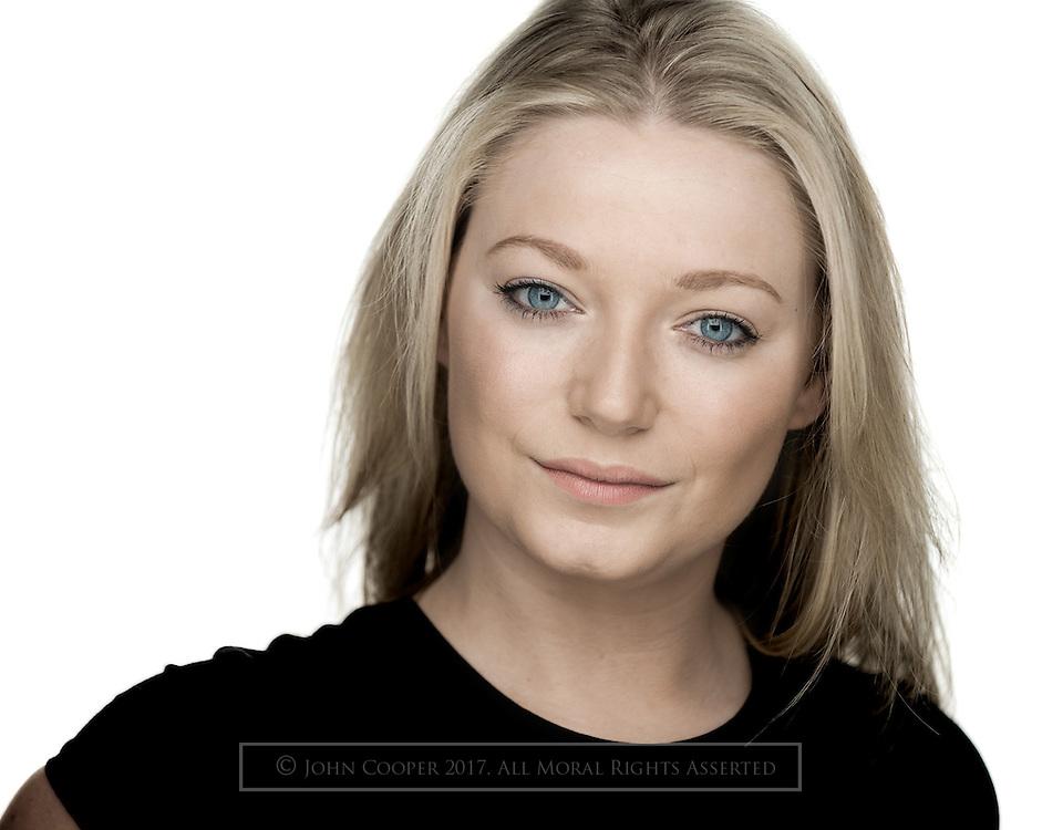 Headshot of actress, Flora Munro.