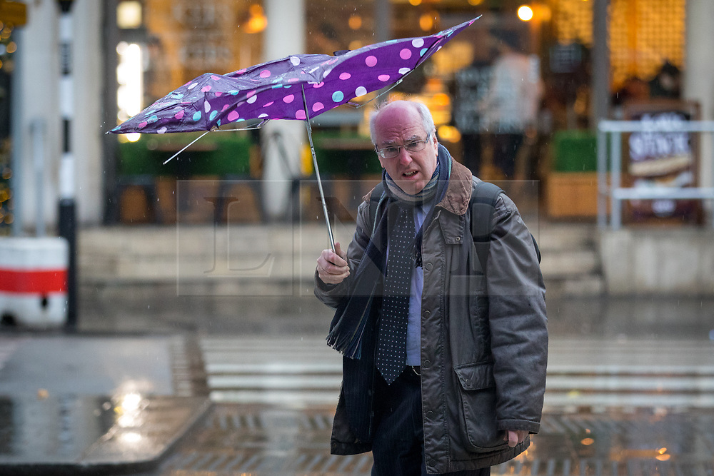 © Licensed to London News Pictures. 15/01/2018. London, UK. Members of the public struggle through wet and windy weather in central London on Blue Monday, dubbed the most depressing day of the year. Photo credit : Tom Nicholson/LNP