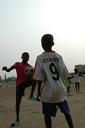 GHANA,Accra,Kokomlemle, 2007. Boys start playing soccer early in Ghana, and emulate their favorite stars with much enthusiasm.