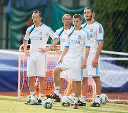 SINGAPORE, SINGAPORE - Sunday, July 17, 2011: Liverpool's new signing Charlie Adam, Raul Meireles, John Flanagan and Andy Carroll during an exhibition training session at the Bishan Stadium in Singapore on day seven of the club's preseason Asia Tour. (Photo by David Rawcliffe/Propaganda)