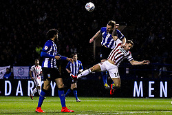 Tom Lees of Sheffield Wednesday challenges Billy Sharp of Sheffield United - Mandatory by-line: Robbie Stephenson/JMP - 04/03/2019 - FOOTBALL - Hillsborough - Sheffield, England - Sheffield Wednesday v Sheffield United - Sky Bet Championship