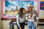 Navajo community leader Daniel Tso greets a fellow activist at a meeting at the chapter house in Counselor New Mexico where the Bureau of Land Management was hearing public comments on proposed new sites for leasing rights to additional drilling in the San Juan Basin.<br />