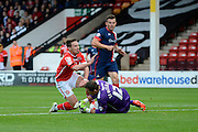 Thorsten Stuckmann claims the ball ahead of Tom Bradshaw during the Sky Bet League 1 match between Walsall and Doncaster Rovers at the Banks's Stadium, Walsall, England on 12 September 2015. Photo by Alan Franklin.