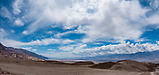 From Artists Drive, look south across the harsh desert landscape to Badwater Basin, the lowest point in North America (282 feet below sea level), which is surrounded by high mountain ranges. Death Valley National Park, California, USA. This image was stitched from multiple overlapping photos.