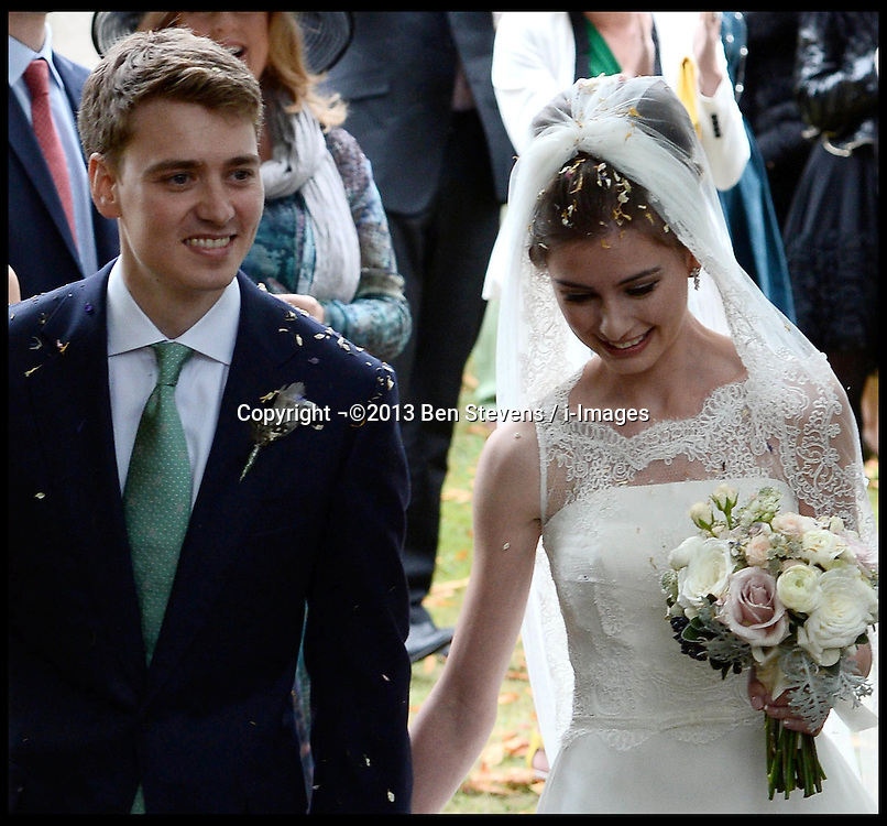 Former Prime Minister Tony Blair's Son Euan Blair Wedding to Suzanne Ashman at All Saints Church in  Wotton Underwood, United Kingdom. Saturday, 14th September 2013. Picture by Ben Stevens / i-Images<br /> <br /> Pictured are Euan Blair and Suzanne Ashman leaving All Saints Church.