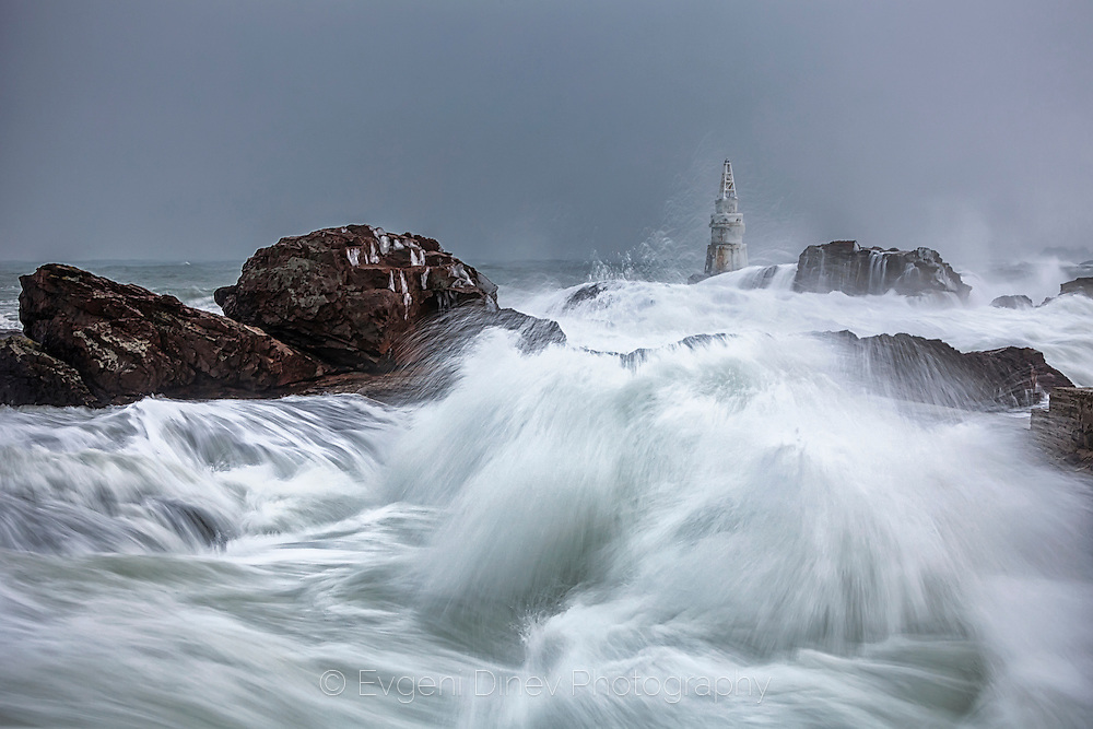 Stormy sea with waves smashing in the lighthouse