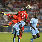 Mamadou Sakho, (top), Liverpool, goes over the back of Kelechi Iheanacho, Manchester City, to win the header during the Manchester City Vs Liverpool FC Guinness International Champions Cup match at Yankee Stadium, The Bronx, New York, USA. 30th July 2014. Photo Tim Clayton