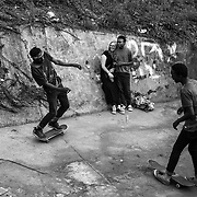Thula (left), Tox (centre), his girlfriend, and Pule (right) are skateboarding and drinking in Soweto. With so little economic opportunities are offered to the black youth, punk and skateboard have become an escape from a system and a lifestyle they don't want to conform to, and the key to freedom. Johannesburg, South Africa. April 2017. © Miora Rajaonary / Native Agency