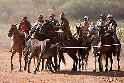 Vaqueiros com boi capturado na caatinga. Vaqueiros na regiao do Agreste , de gibao de couro, vestimenta tipica do vaqueiro nordestino utilizada para proteger-se quando encontra-se em corrida nas matas, caatinga,  tentando dominar um animal. /  Cowboys bring in the bull rope caught in the woods. Cowboys in the region of the Wasteland, a leather jerkin, typical cowboy attire used to protect the Northeast when the race is in the woods, scrub, trying to dominate an animal .Foto Adri Felden/Argosfoto