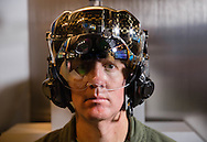 "Col. Todd Canterbury demonstrates the F-35 Helmet Mounted Display System at Lockheed Martin offices in Arlington, VA on Sept. 3, 2015. The F-35 Helmet Mounted Display System provides pilots with unprecedented situational awareness by projecting Heads-up Display information into the visor as well as real-time imagery from six infrared cameras mounted around the aircraft, which allows the pilot to ""look through"" the airframe. The helmet also includes an integrated night vision camera.  (Alan Lessig/Staff)"