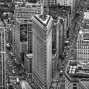 An elevated look at the iconic Flatiron Building in Midtown Manhattan, nyc, built in the early 1900s, it was a monument to innovative building design. Photo taken from the perspective of the Empire State Building's observation deck via my telephoto lens at 180mm of focal length.