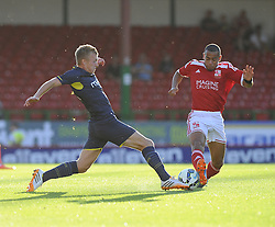 Southampton's James Ward-Prowse battles for the ball with Swindon Town's Louis Thompson - Photo mandatory by-line: Joe Meredith/JMP - Mobile: 07966 386802 21/07/2014 - SPORT - FOOTBALL - Swindon - County Ground - Swindon Town v Southampton