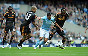 Carlos Tevez takes on Alex and Michael Essien during the Barclays Premier League match between Manchester City and Chelsea at the City of Manchester Stadium on September 25, 2010 in Manchester, England.