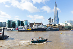 © Licensed to London News Pictures. 12/09/2017. LONDON, UK.  A support boat passes in front of THV Galatea which has arrived in London and is moored next to HMS Belfast in front of the Shard for London International Shipping Week. THV Galatea is a Trinity House multi-function ship, designed to carry out marine operations as part of their duty as the General Lighthouse Authority for England, Wales, the Channel Islands and Gibraltar. An estimated 15,000 shipping industry leaders are expected to attend events in London and on board the THV Galatea during International Shipping Week this week. Photo credit: Vickie Flores/LNP