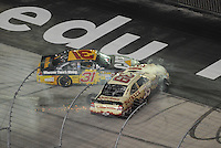 Aug 25, 2012; Bristol, TN, USA; Sprint Cup Series driver Jeff Burton (31) runs into driver Ryan Newman (39) after Newman crashed during the IRWIN Tools Night Race a Bristol Motor Speedway. Mandatory Credit: Randy Sartin-US PRESSWIRE