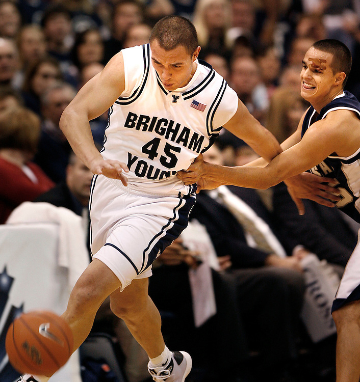 BYU guard Jonathan Tavernari (45), of Brazil, steals the ball away from Utah State guard Jaxon Myaer (25)  and gets fouled on the play during BYU's 68-63 win over USU at the Energy Solutions Arena in Salt Lake City, Utah Saturday Dec. 6, 2008. August MIller/ Deseret New.