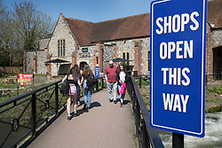 © Licensed to London News Pictures. 20/04/2018. Salisbury, UK. A sign placed near The Mill pub says 'shops open this way' as a cleanup operation begins in Salisbury. Former Russian Spy Sergei Skripal and his daughter Yulia were poisoned using a nerve agent in the city last month. Experts have warned that 'Toxic levels' of the nerve agent novichok could still be present at hot spots around the city. Photo credit: Peter Macdiarmid/LNP