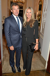 AMANDA WAKELEY and HUGH MORRISON at a party to kick off London Fashion Week hosted by US Ambassador Matthew Barzun and Mrs Brooke Brown Barzun with Alexandra Shulman in association with J.Crew hrld at Winfield House, Regent's Park, London on 18th September 2015.