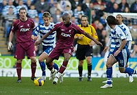 Photo: Gareth Davies.<br />Reading v Bolton Wanderers. The Barclays Premiership. 02/12/2006.<br />Bolton's Abdoulaye Meite (C) takes on the Reading players.
