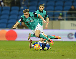 Blackburn Rovers's Tom Cairney goes flying after being fouled by Cardiff City's Matthew Kennedy - Photo mandatory by-line: Alex James/JMP - Mobile: 07966 386802 - 17/02/2015 - SPORT - Football - Cardiff - Cardiff City Stadium - Cardiff City v Blackburn Rovers - Sky Bet Championship