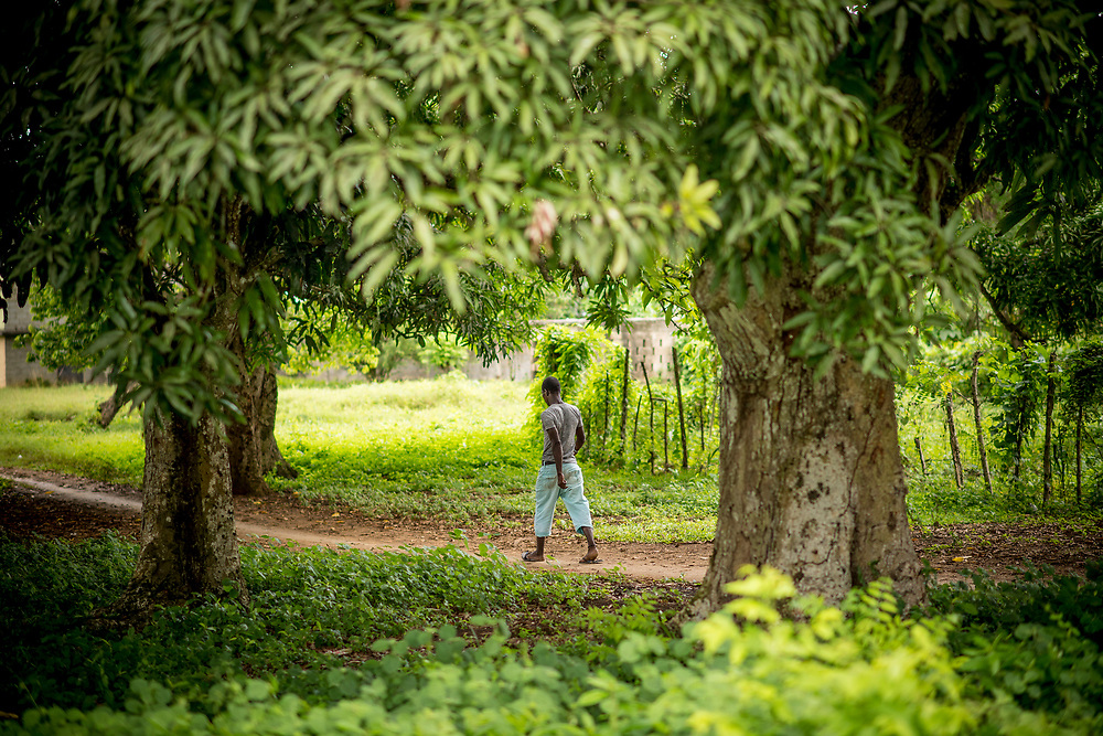 July 21, 2017, Boston, MA:<br /> A local man walks down a pathway in El Mam&oacute;n during the 2017 Lindos Sue&ntilde;os trip in the Dominican Republic Friday, July 21, 2017. <br /> (Photo by Billie Weiss/Boston Red Sox)
