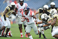 Ole Miss Rebels running back Jaylen Walton (6) runs 20 yards for a first quarter touchdown against Vanderbilt Commodores linebacker Darreon Herring (35) and Vanderbilt Commodores defensive back Torren McGaster (5) at L.P. Field in Nashville, Tenn. on Saturday, September 6, 2014. Ole Miss won 41-3.
