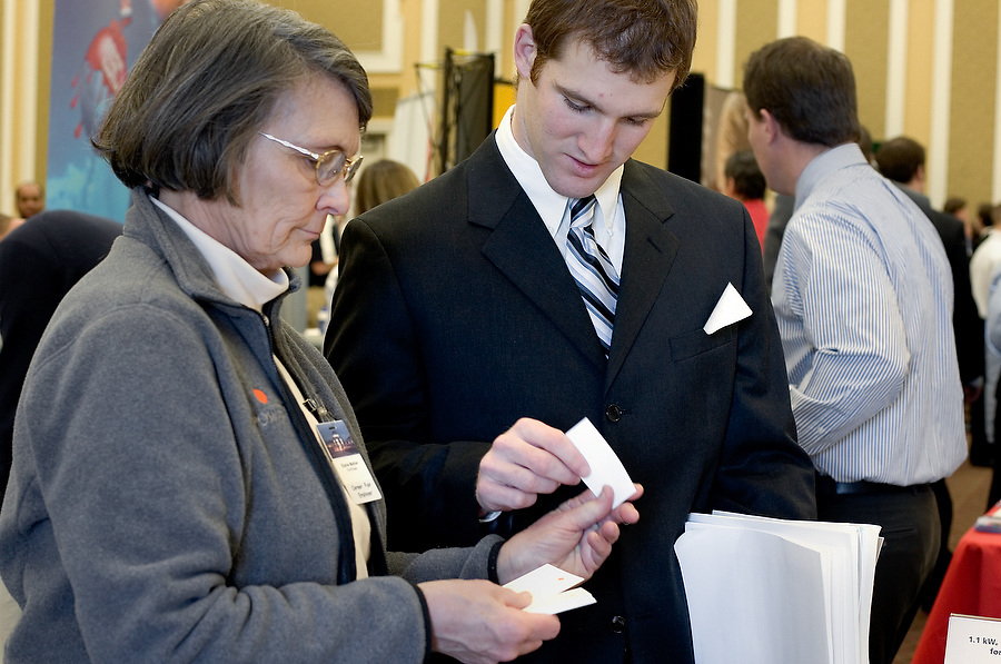 Elaine Mather with Sunpower talks with student David Jones during the Job Fair in the Baker Center ballroom on Monday 2/5/07.