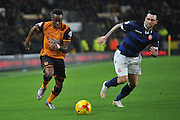 Hull City midfielder Moses Odubajo and Bolton Wanderers midfielder Mark Davies during the Sky Bet Championship match between Hull City and Bolton Wanderers at the KC Stadium, Kingston upon Hull, England on 12 December 2015. Photo by Ian Lyall.
