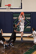 McNeil Junior Kailan Bray secures the rebound against Cedar Ridge Friday.  (LOURDES M SHOAF for Round Rock Leader.)