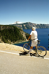OR: Oregon; Crater Lake National Park, bicycling, model released           .Photo Copyright Lee Foster, lee@fostertravel.com, www.fostertravel.com, (510) 549-2202.Image orcrat210