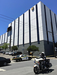 June 14, 2017 - San Francisco, California, U.S. - A policeman patrols outside a UPS facility where shootings occurred in San Francisco. Six people were shot Wednesday morning at a UPS facility in San Francisco and four were killed, including the shooter. An UPS employee opened fire at a San Francisco package delivery facility. (Credit Image: © Ma Dan/Xinhua via ZUMA Wire)