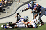 Oklahoma State quarterback Bobby Reid (14) reaches up for the fumbled ball, after getting tackled by Kansas State defensive end Ian Campbell (98) in the first half, at Bill Snyder Family Stadium in Manhattan, Kansas, October 7, 2006.  The Wildcats beat the Cowboys 31-27.<br />