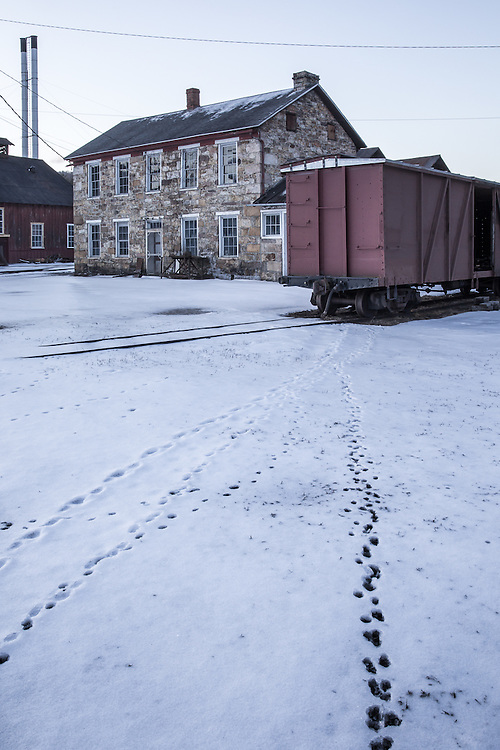 Tracks of steel and fur lead to an isolated boxcar at the East Broad Top Shops