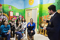 LECCE, ITALY - 10 NOVEMBER 2016: Marco Albanese (right), a policeman for 19 years and trained sommelier for five, volunteers to lecture female inmates on the arts and crafts of wine tasting and serving, in the largest penitentiary in the southern Italian region of Apulia, holding 1,004 inmates in the outskirts of Lecce, Italy, on November 10th 2016.<br /> <br /> Here a group of ten high-security female inmates and aspiring sommeliers , some of which are married to mafia mobsters or have been convicted for criminal association (crimes carrying up to to decades of jail time), are taking a course of eight lessons to learn how to taste, choose and serve local wines.<br /> <br /> The classes are part of a wide-ranging educational program to teach inmates new professional skills, as well as help them develop a bond with the region they live in.<br /> <br /> Since the 1970s, Italian norms have been providing for reeducation and a personalized approach to detention. However, the lack of funds to rehabilitate inmates, alongside the chronic overcrowding of Italian prisons, have created a reality of thousands of incarcerated men and women with little to do all day long. Especially those with a serious criminal record, experts said, need dedicated therapy and professionals who can help them.