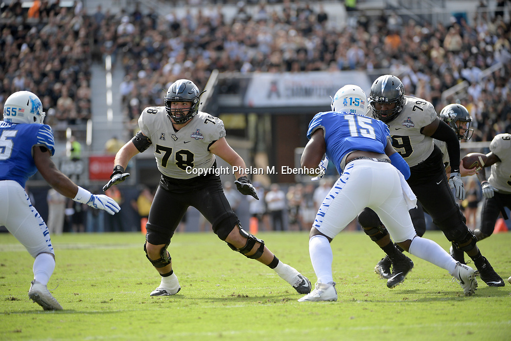 Central Florida offensive lineman Wyatt Miller (78) and offensive lineman Chavis Dickey (79) set up to block against Memphis linebacker Bryce Huff (55) and defensive lineman Christian Johnson (15) during the first half of the American Athletic Conference championship NCAA college football game Saturday, Dec. 2, 2017, in Orlando, Fla. (Photo by Phelan M. Ebenhack)