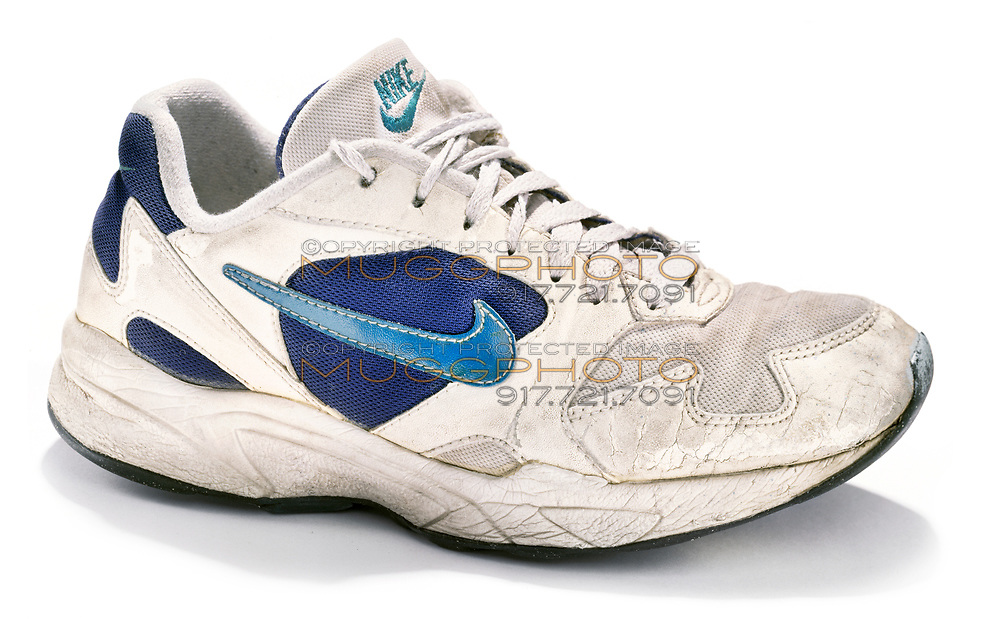 Old Nike sneaker on white background